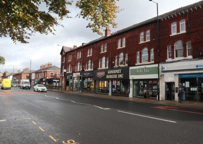 Parade of shops along Wilmslow Road, Didsbury, South Manchester