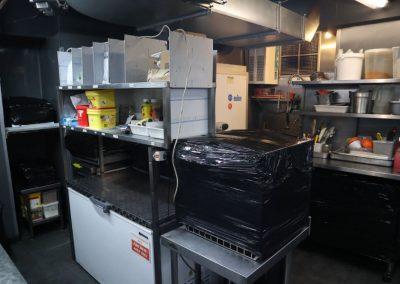 Kitchen area within 48 Portland Street Manchester